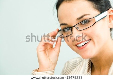 Face of gorgeous business woman touching her glasses