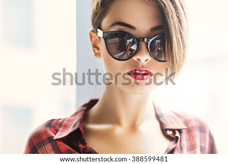 Face of gorgeous woman in sunglasses