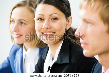 Face of handsome businesswoman looking at camera with smile - stock photo