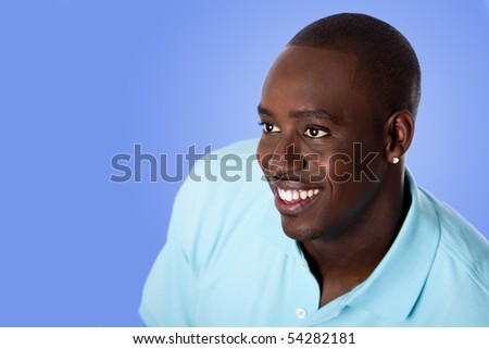 Face of handsome happy African American corporate business man smiling, wearing blue polo shirt, isolated. - stock photo