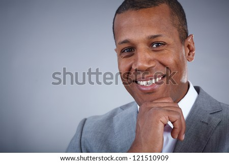 Face of happy Afro-American businessman looking at camera with smile - stock photo