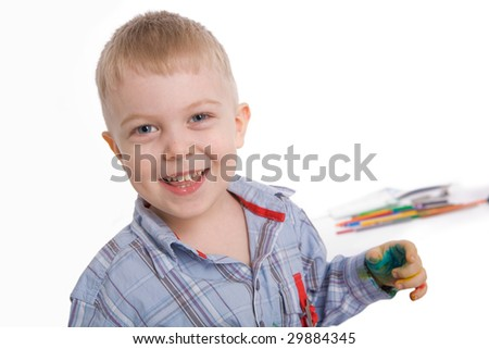 Face of happy child looking at camera with smile - stock photo