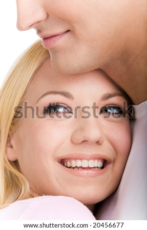 Face of laughing girl looking aside on her boyfriend shoulder - stock photo