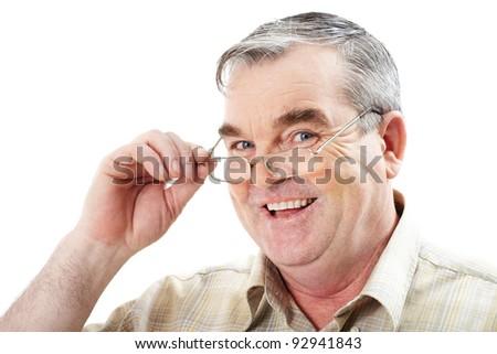 Face of mature man in eyeglasses looking at camera - stock photo