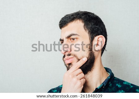 Face of one intelligent bearded man - stock photo