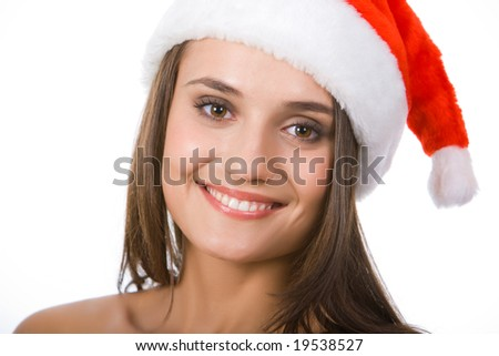 Face of pretty smiling girl wearing christmas cap over white background