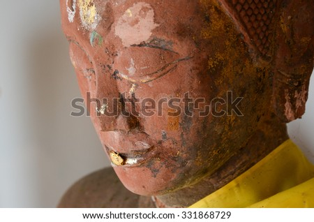 Face of red stone Buddha statue  - stock photo