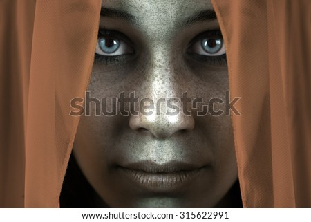 Face of shy freckled woman with veil and beautiful big eyes - stock photo