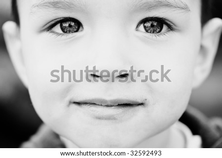 Face of small kid close up - stock photo