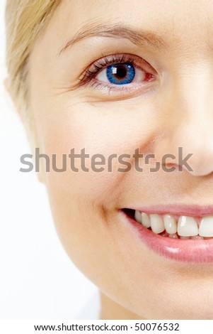 Face of smiling female looking at camera in isolation