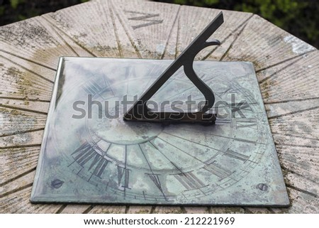 face of sundial wet with rain