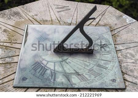 face of sundial wet with rain - stock photo