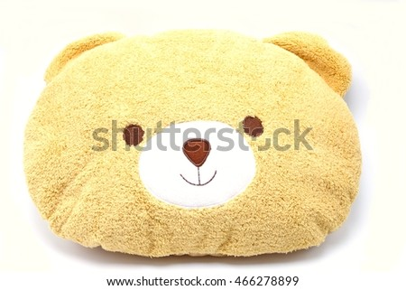 face of  teddy bear pillow on white background