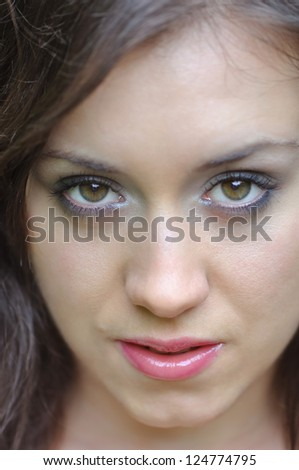 Face of the beautiful girl close up - stock photo