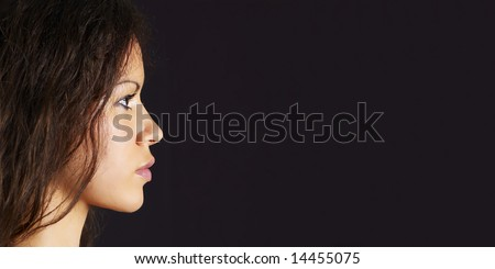 face of the beautiful girl in profile - stock photo