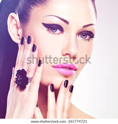 Face of the  beautiful sexy  woman with black nails and pink lips. Sexy girl with fashion makeup - stock photo