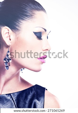 Face of the  beautiful sexy  woman with glamour fashion makeup of eyes and gloss hairstyle. Profile portrait of the caucasian adult girl at studio - stock photo