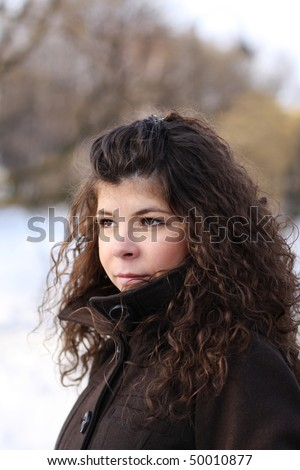 face of the girl in winter - stock photo