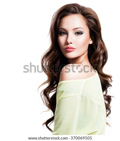 Face of the sensuality beautiful woman with long brown curly hair in yellow shirt - stock photo