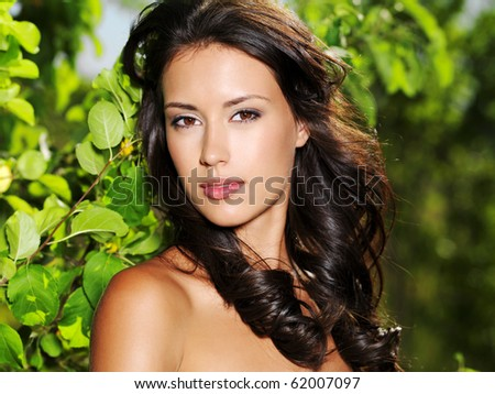 Face of the young beautiful sexy woman outdoors - stock photo