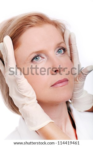 Face of woman and doctor hands in gloves. Plastic surengy concept.
