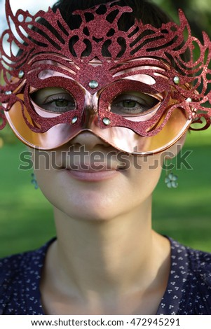 Face of woman in mask on festival