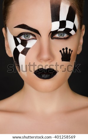 face of woman with black and white pattern on black background - stock photo