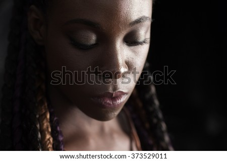 face of young afro-american braided woman - stock photo
