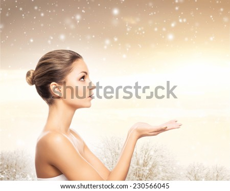 Face of young and healthy girl over winter background with a snowflakes  - stock photo
