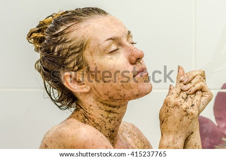 Face of young beautiful sexy girl with long hair girl who takes a bath naked in the spa procedures, wellness dealt a protective mask of coffee for skin health - stock photo