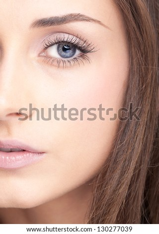 Face of young beautiful woman with day makeup - stock photo
