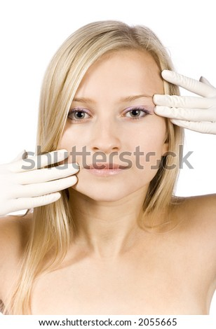 face of young blonde woman + her hands in gloves (pure white background) - stock photo