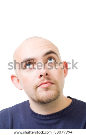 Face of young bold man thinking and dreaming looking up,isolated on white - stock photo