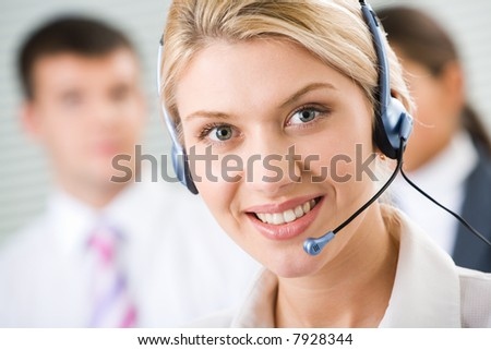 Face of young charming confident woman with headset - stock photo