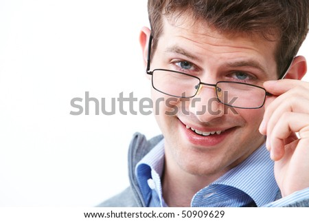 Face of young handsome businessman in eyeglasses looking at camera - stock photo