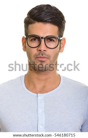 Face of young handsome Persian man with eyeglasses isolated against white background