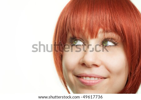 Face of young redhead woman having an idea - stock photo