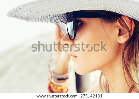 Face of young summer sexy woman wearing hat  and sunglasses. Outdoors lifestyle portrait - stock photo