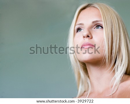 Face of young woman close up - stock photo