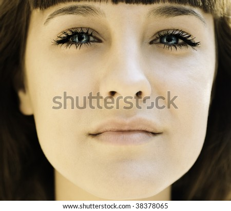 face of young woman in closeup - stock photo