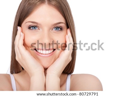 face of young woman with clean skin, isolated on white background - stock photo