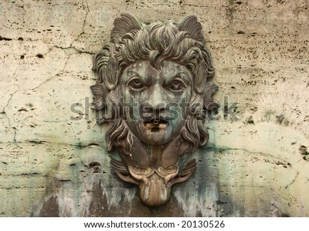 Face on a Water Fountain with Patina