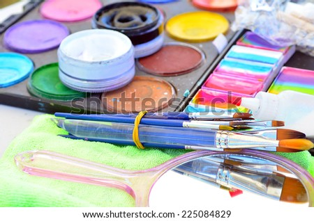 Face painting colors and tools of face painting artist. Concept photo artwork, art and craft. - stock photo