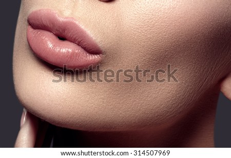 Face part. Beautiful female lips with natural makeup, clean skin