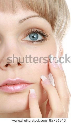 Face part of beautiful woman with blue eyes touching her face isolated on white background