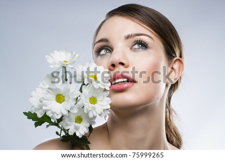 Face portrait of a beautiful woman, neutral background