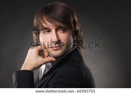 Face portrait of a handsome man against black background