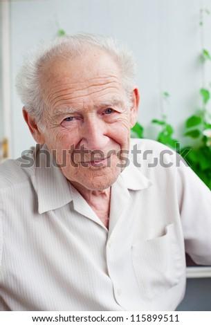 face portrait of a senior man - stock photo