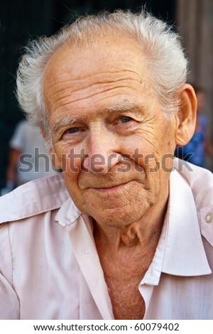 face portrait of a smiling senior man - stock photo