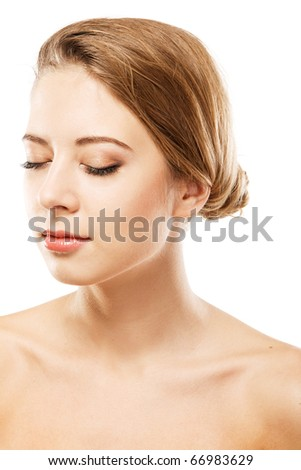 Face portrait of a young beautiful model over white background - stock photo